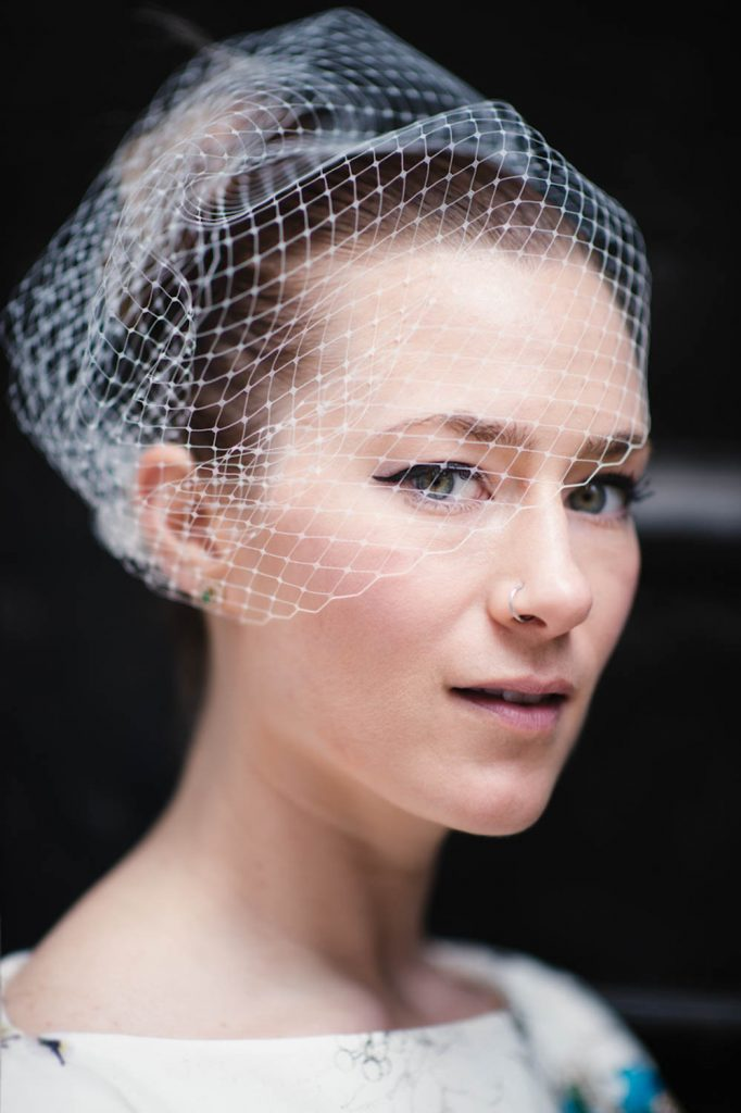 Portrait of a bride in her beautiful handmade birdcage