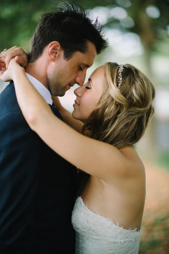 Couple with their eyes closed touching noses and about to kiss