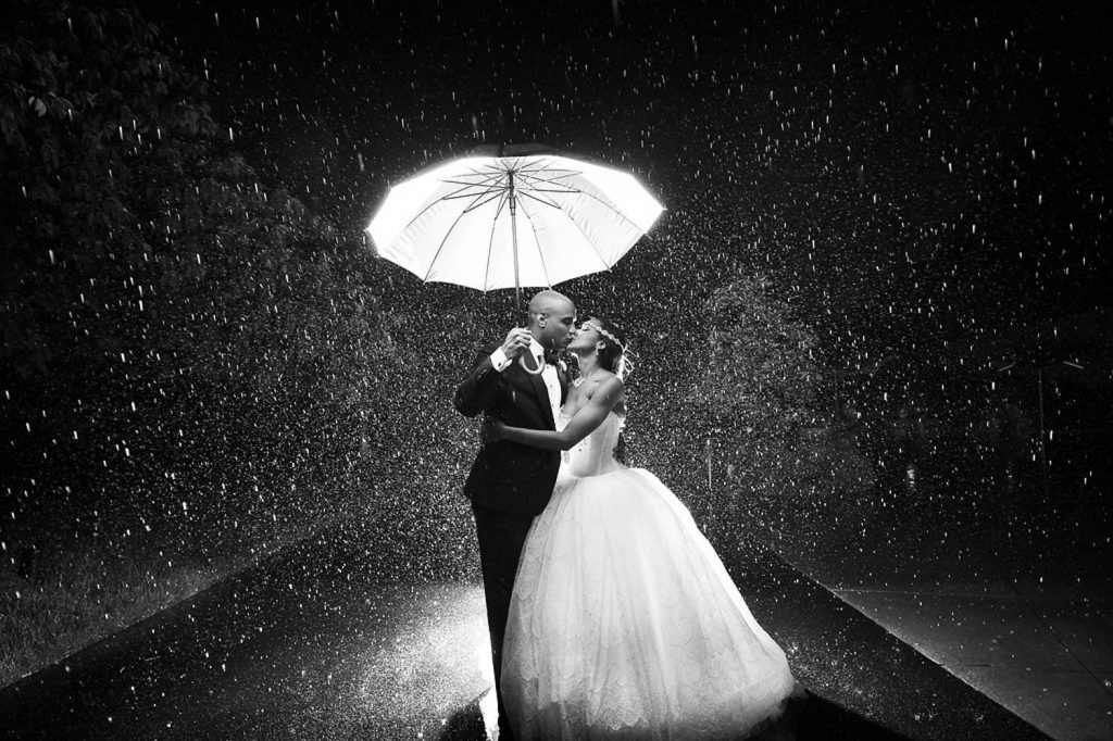 Black and white photo of a beautiful couple in the rain